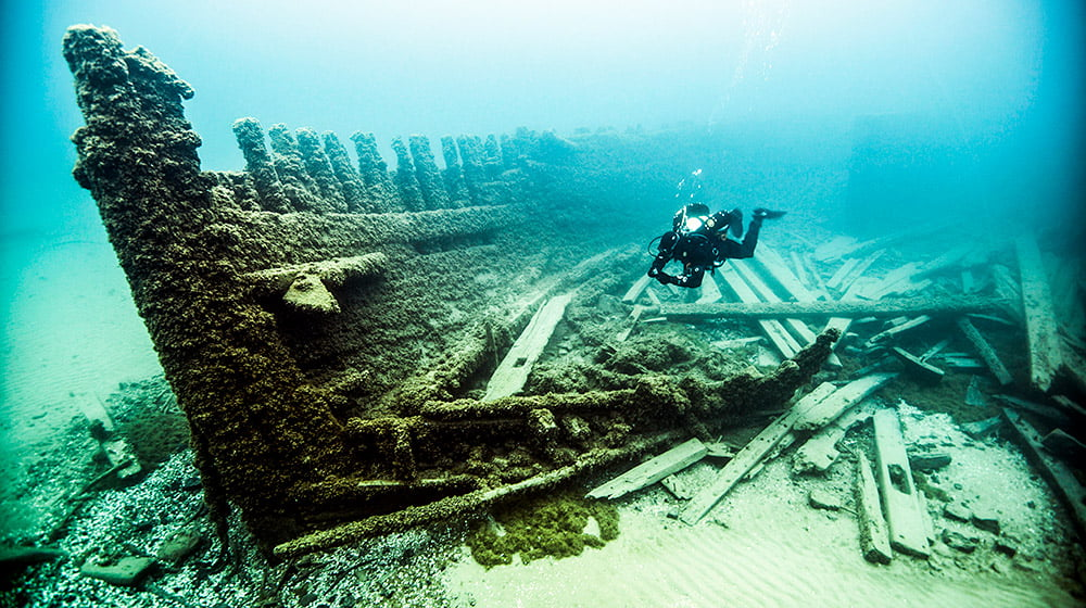 diver examining the wreck of the van valkenburg