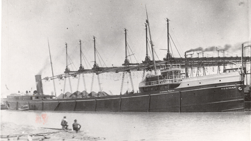 A black and white photo of a ship